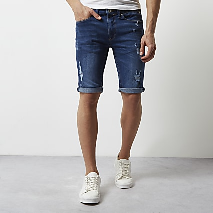 Mid blue wash skinny ripped denim shorts