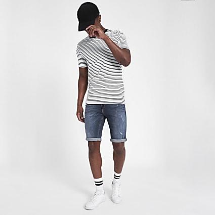 Mid blue distressed Sid skinny denim shorts