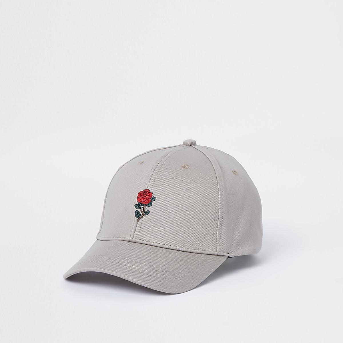Beige baseballpet met rozenprint