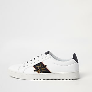 White wasp embroidered trainers