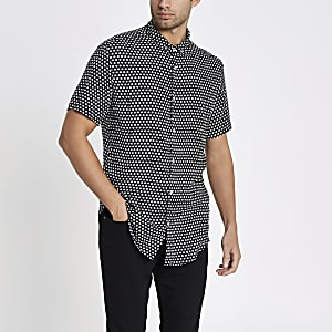 Chemise slim manches courte à petites fleurs noire