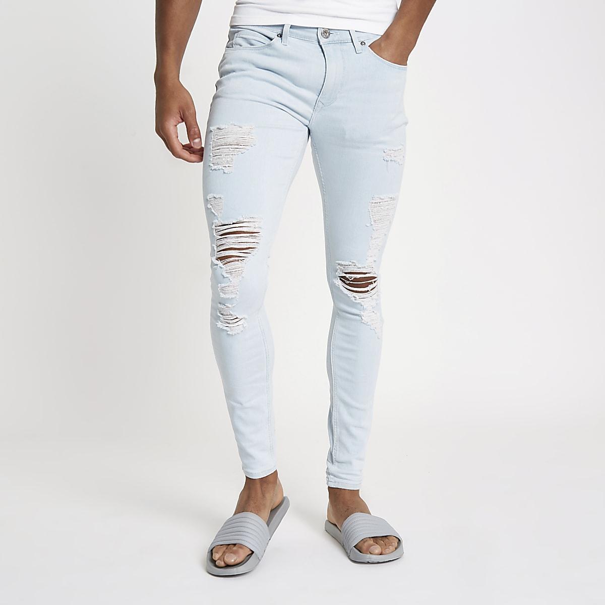 Light blue Ollie ripped spray on skinny jeans
