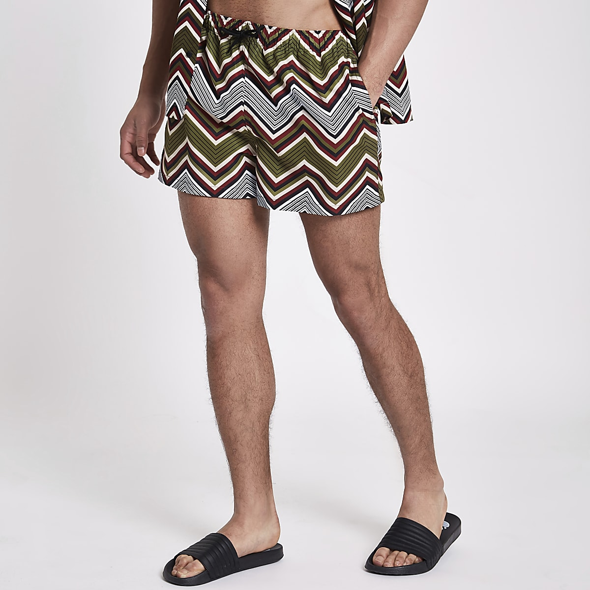Green zig zag print swim shorts