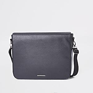 Black faux leather flapover satchel bag