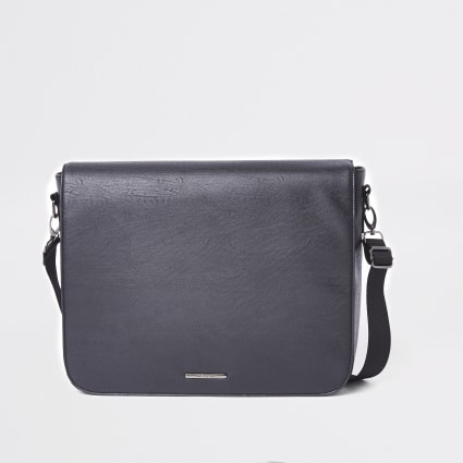 Black faux leather flapover satchel bag