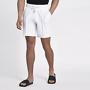 White pintuck wasp embroidered slim shorts