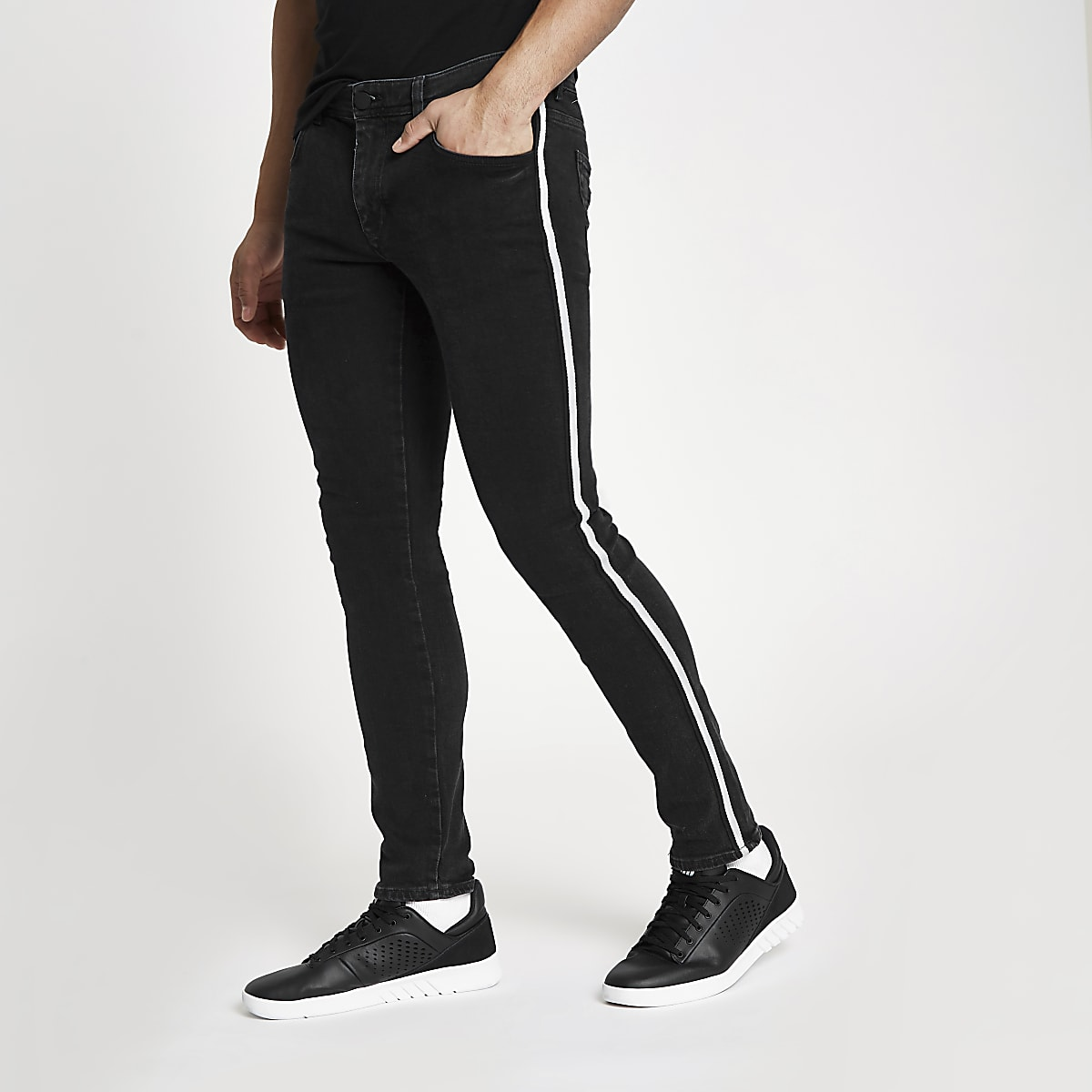 Black wash skinny fit tape side jeans