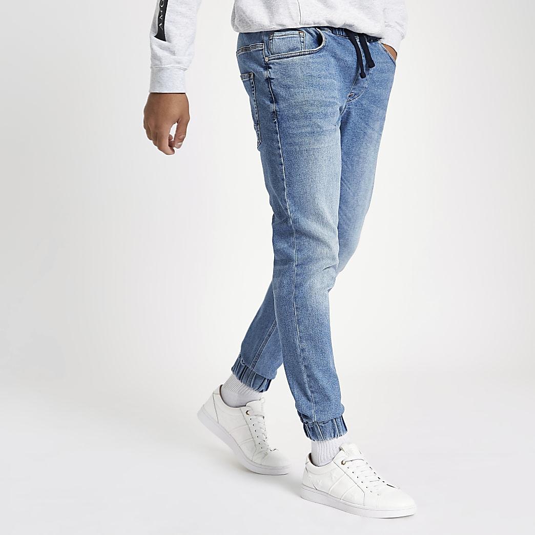 Ryan – Jean bleu mi-délavé style pantalon de jogging