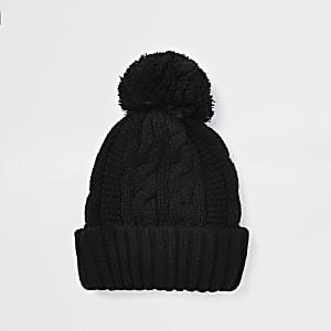 Bonnet en maille torsadée noir à pompon