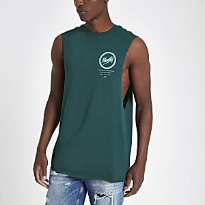 Groene tanktop met 'Ninety'-print