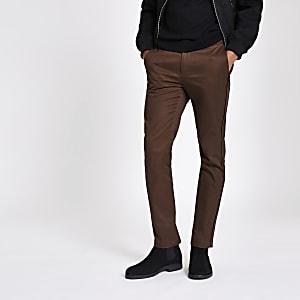 Bruine skinny-fit broek met bies opzij