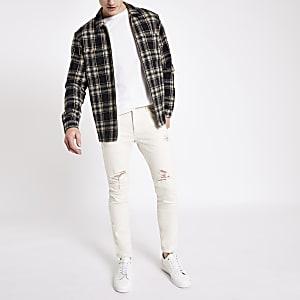 Jean skinny blanc déchiré à bandes