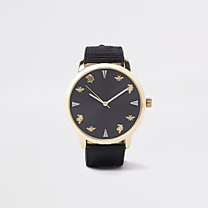 Black and gold tone fabric strap watch