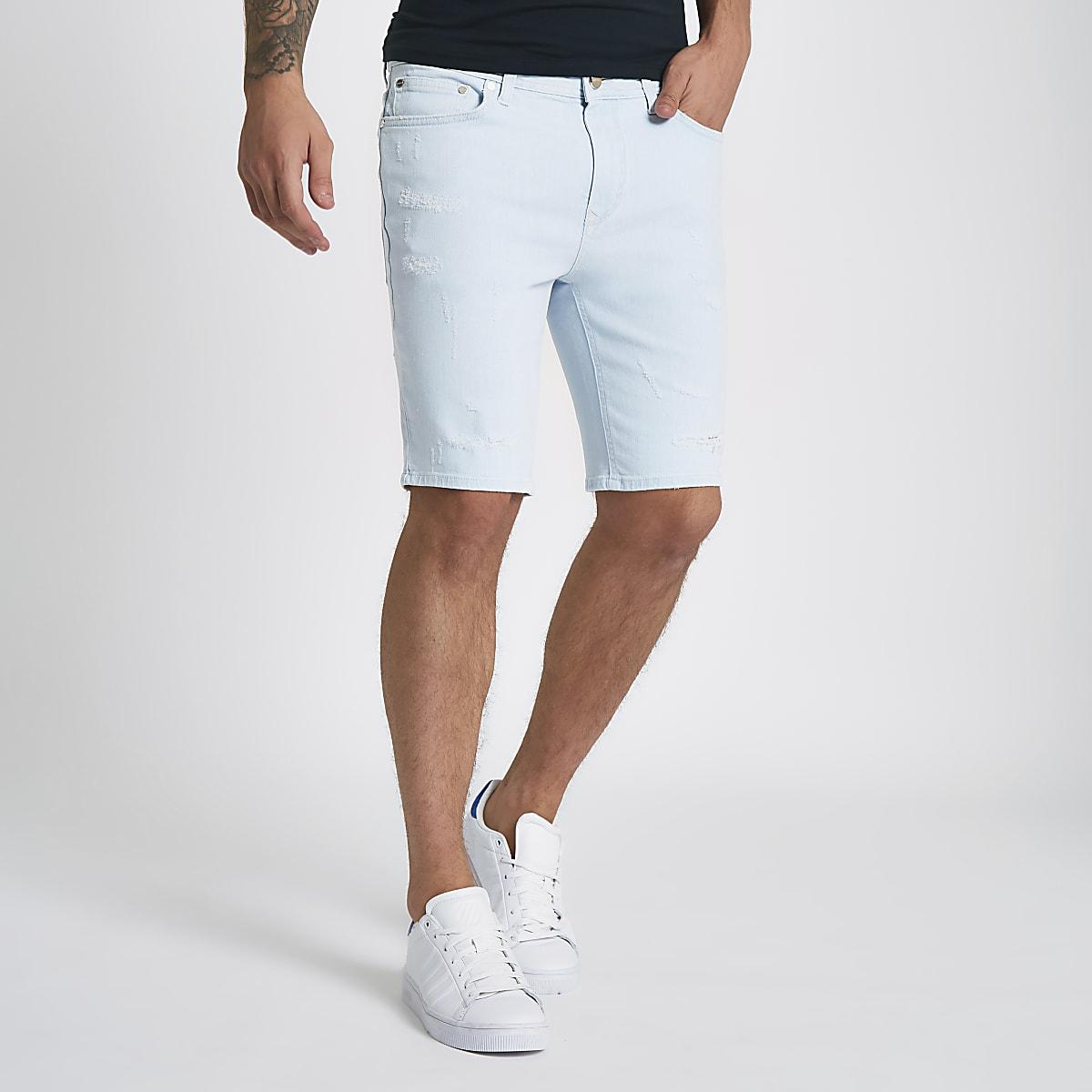 Light blue skinny ripped denim shorts