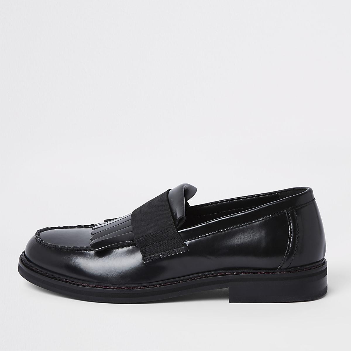Black leather fringe loafers