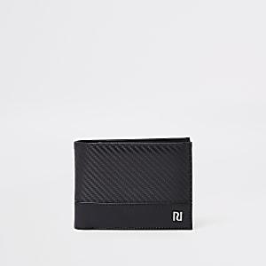Zwarte portemonnee met contrasterende details en textuur