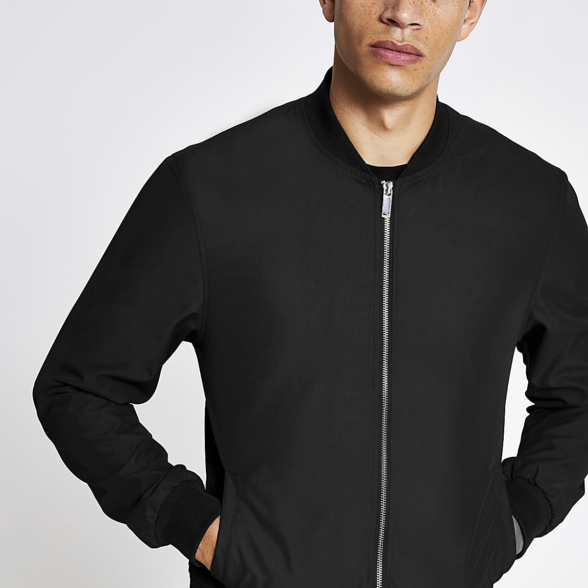 77ce11392 Black zip-up bomber jacket