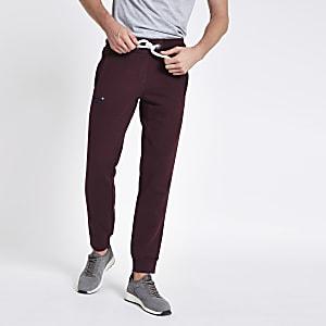 Superdry – Pantalon bordeaux resserré aux chevilles
