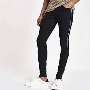 Black Ollie skinny spray on piped  jeans