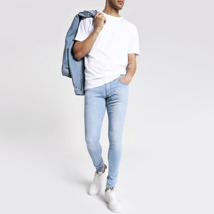 Light blue Ollie spray on faded skinny jeans
