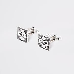 Silver tone cufflinks