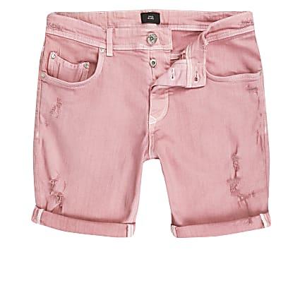 Pink skinny ripped denim shorts