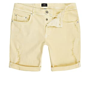 Yellow skinny ripped denim shorts