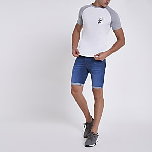 Mid blue skinny rolled hem denim shorts