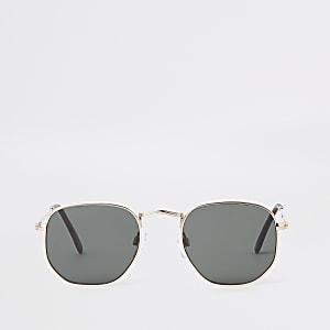 Goudkleurige zonnebril met zeshoekig montuur en zwarte glazen