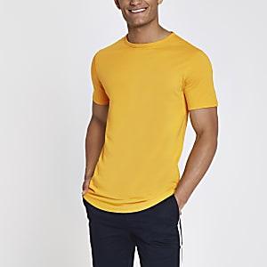 Geel lang T-shirt met ronde zoom