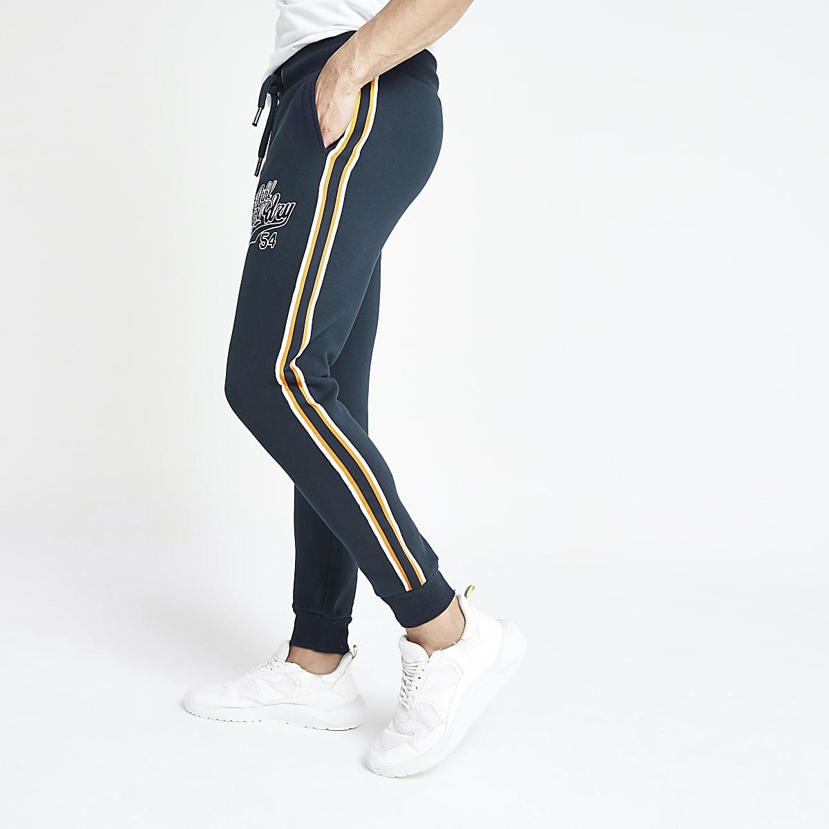 Superdry - Marineblauwe joggingbroek met appliqué