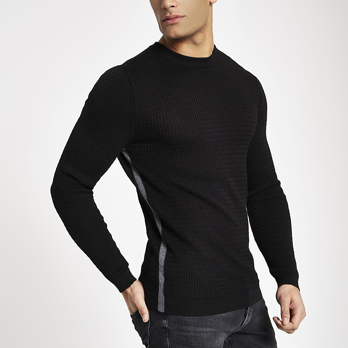 Zwarte aansluitende pullover met kabelmotief