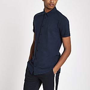 Chemise ajustée bleu marine à broderie et fermeture boutonnée