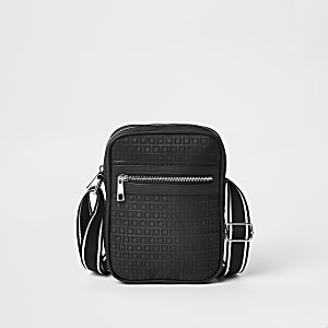 Black RI monogram cross body flight bag