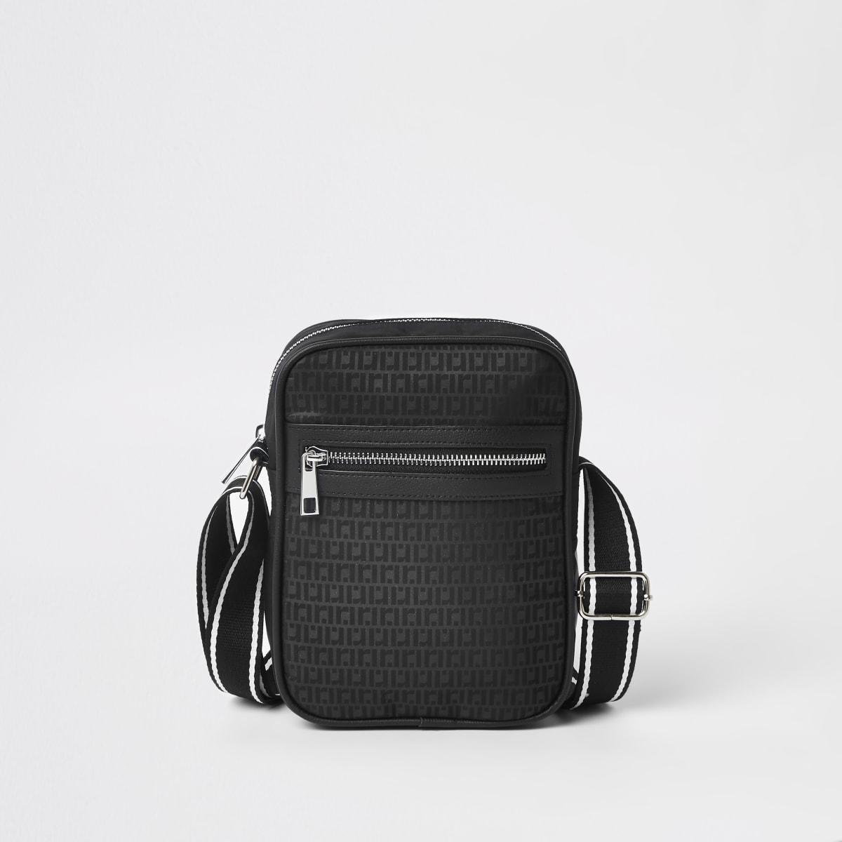 Black RI monogram cross body flight bag