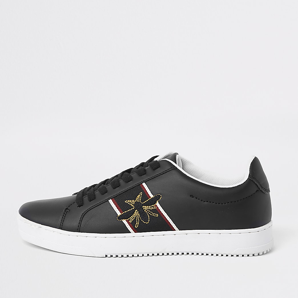 Black wasp embroidered trainers