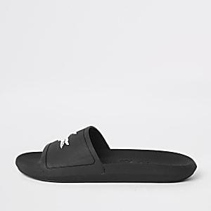 Lacoste – Claquettes texturées noires