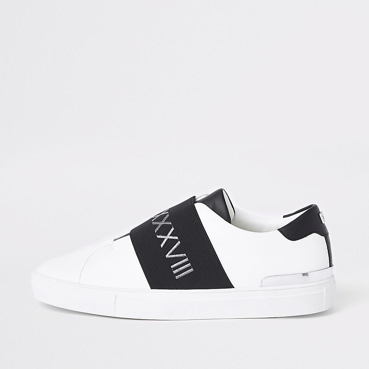White elastic slip on runner sneakers