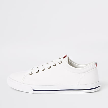 White canvas lace-up plimsolls