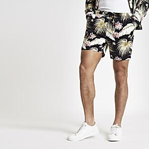 Zwarte short met elastiek en bloemenprint