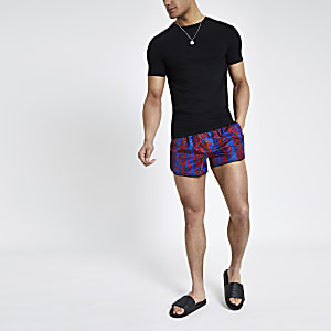 Red snake print runner swim trunks