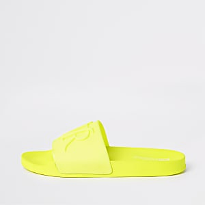 Bright yellow embossed 'RVR' sliders