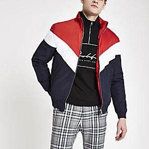 Rood gewatteerd jack met zigzagmotief en opstaande kraag