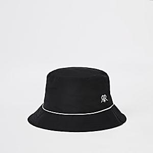 Omkeerbare zwarte bucket hat met bies