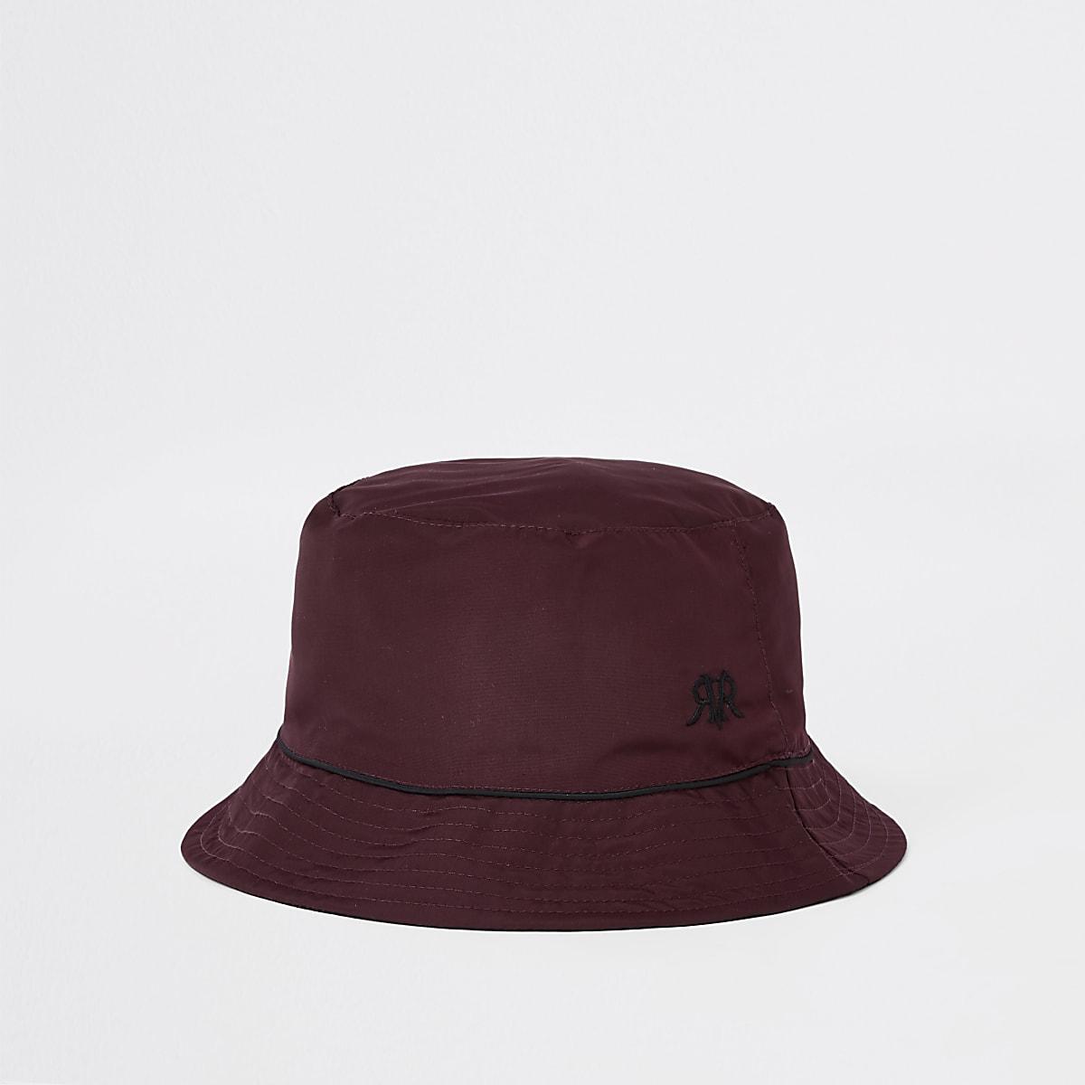 Omkeerbare bordeauxrode bucket hat  met bies