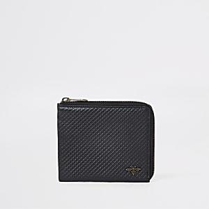 Pochette zippée en cuir texturée noire motif guêpe