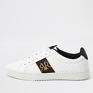 Witte sneakers met RI-monogram