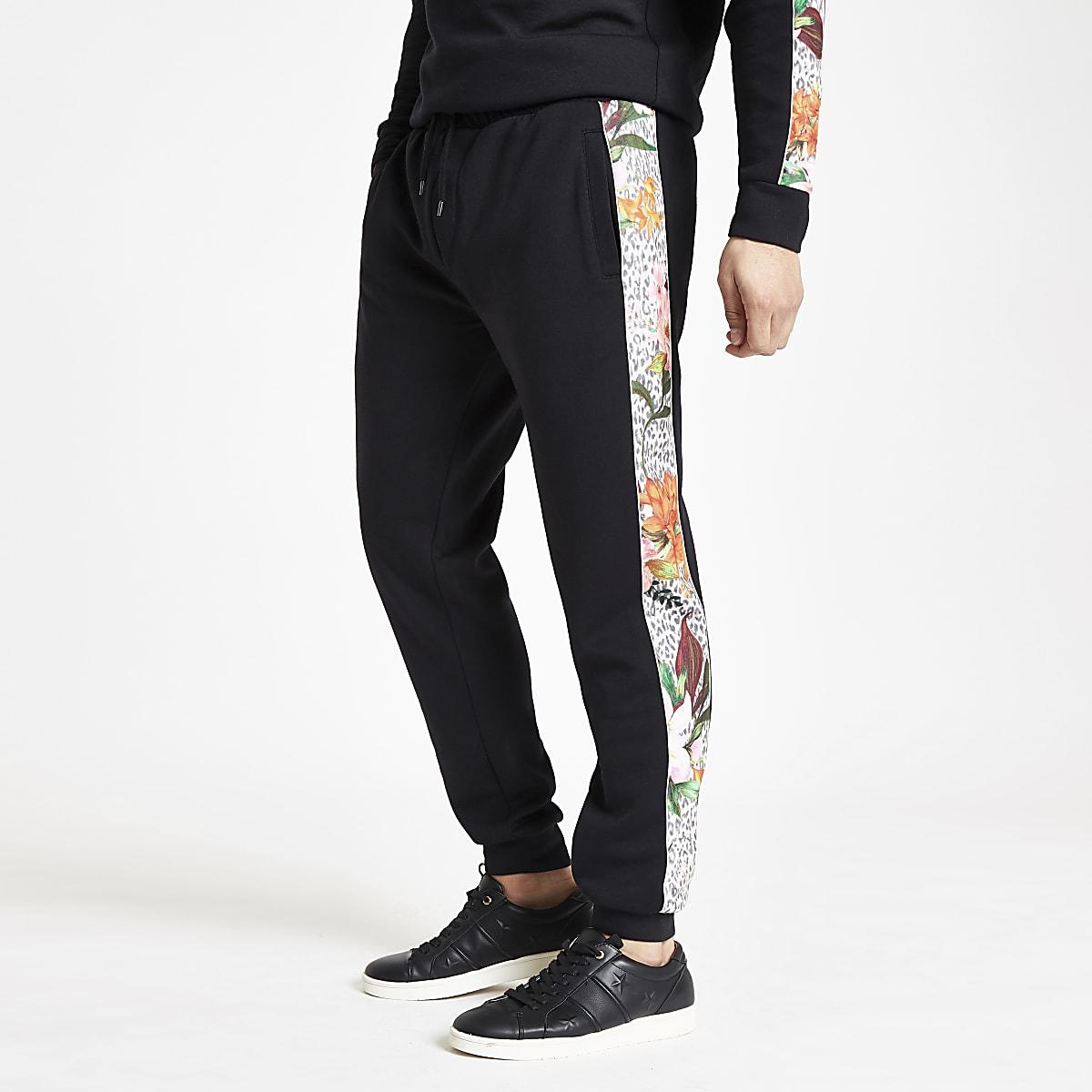Zwarte slim-fit joggingbroek met luipaard- en bloemenprint