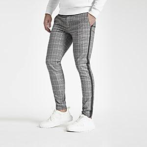 Pantalon skinny à carreaux gris avec bandes latérales