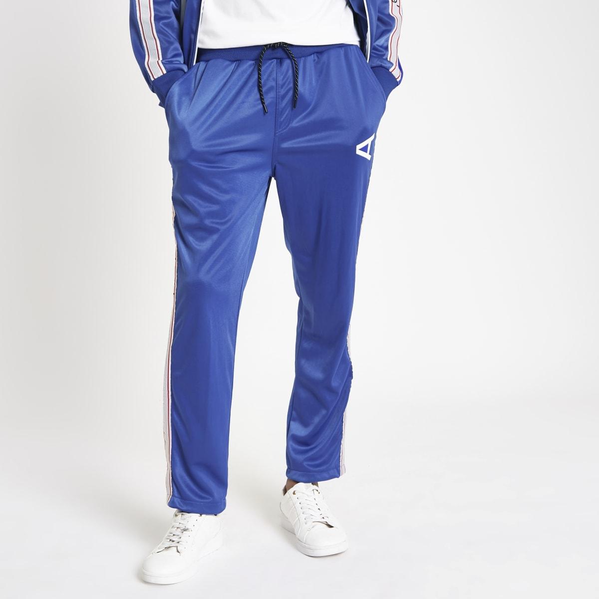 Arcminute - Blauwe joggingbroek met bies opzij